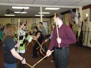 Adults trying out a lesson at the Easton Martial Arts Center.